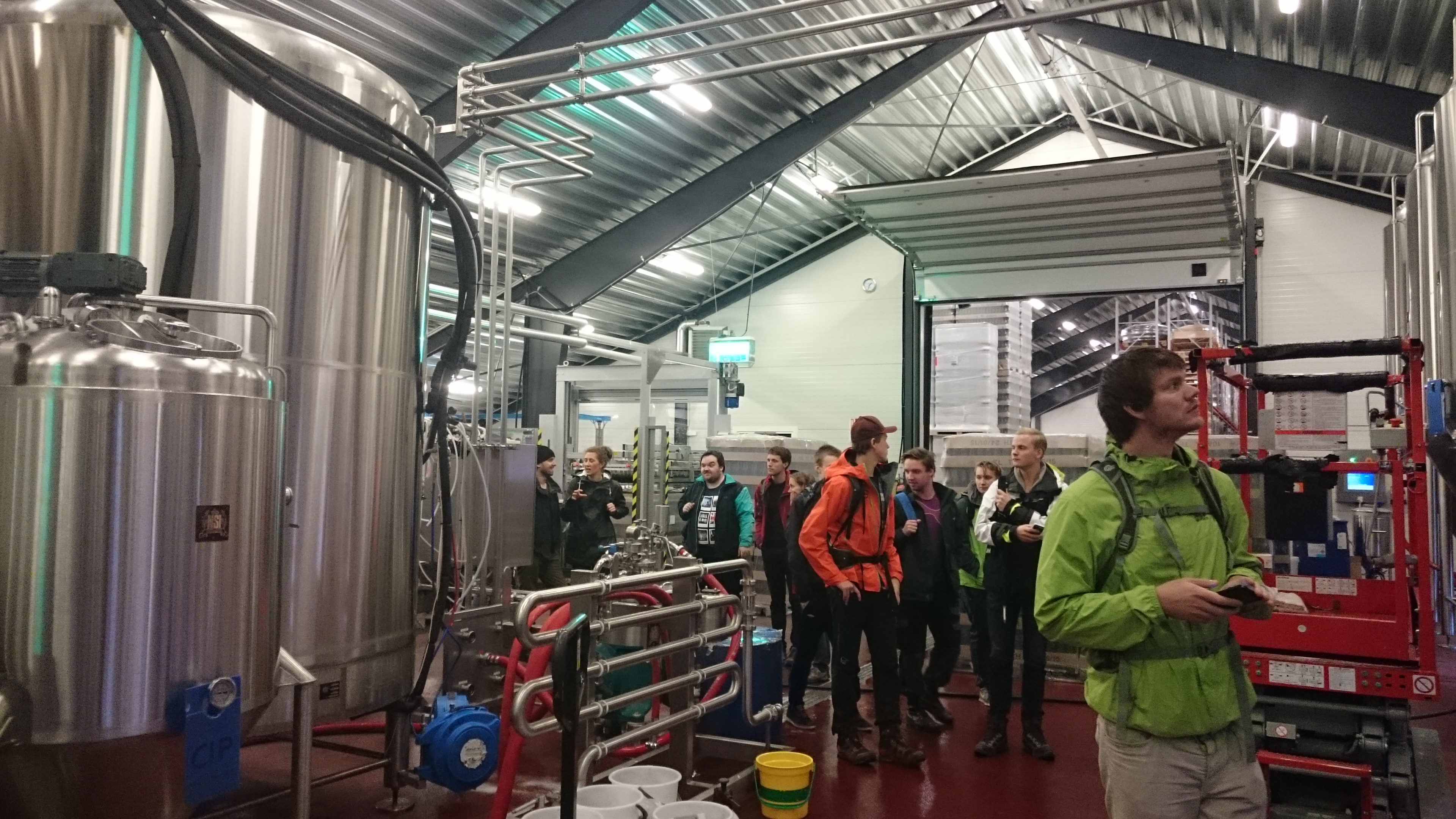 Students and staff walk around and admire the stainless steel design beads where the local Ægir brewery is producing its craft beer.